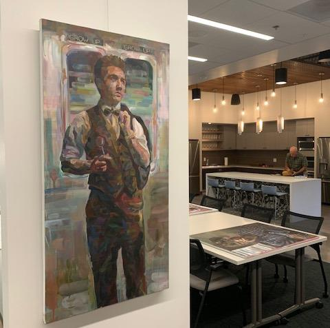 Student artwork hangs in the office building of Rainforth Grau Architects