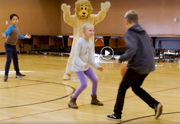 Navigator students playing basketball with Slamson mascot