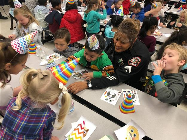 RCPD celebrating K9 Zoe's Birthday with kindergarteners at a table doing crafts