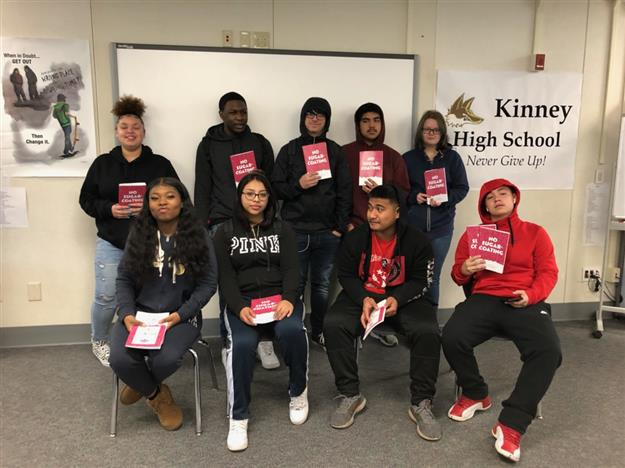 Students at Kinney High School showing off their newly published books