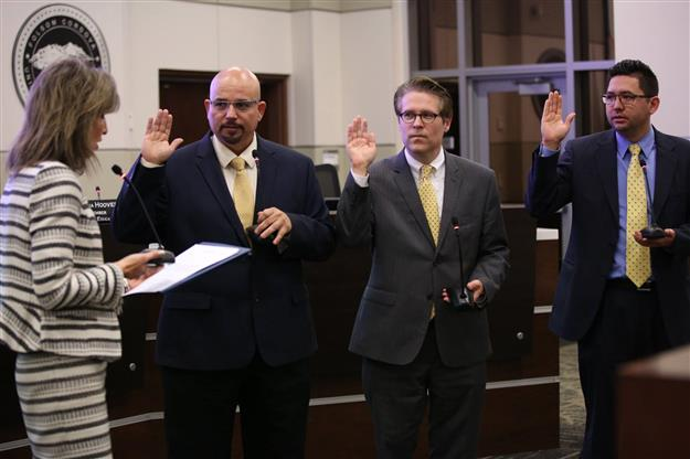 Three Board of Education members sworn into office