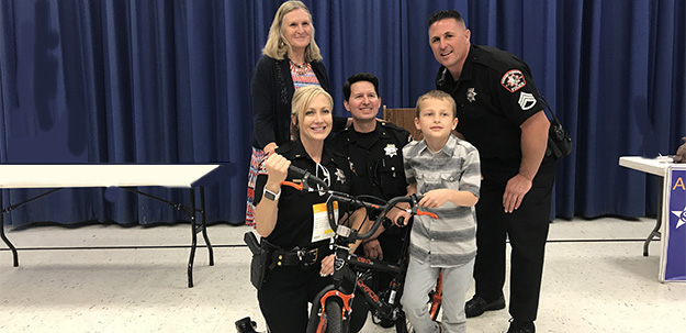 VIDEO: RCPD surprises Cordova Gardens student with bike