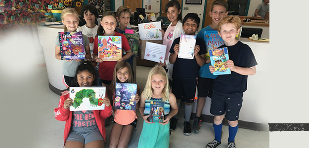Natoma Station PTO donates books to Community Readers
