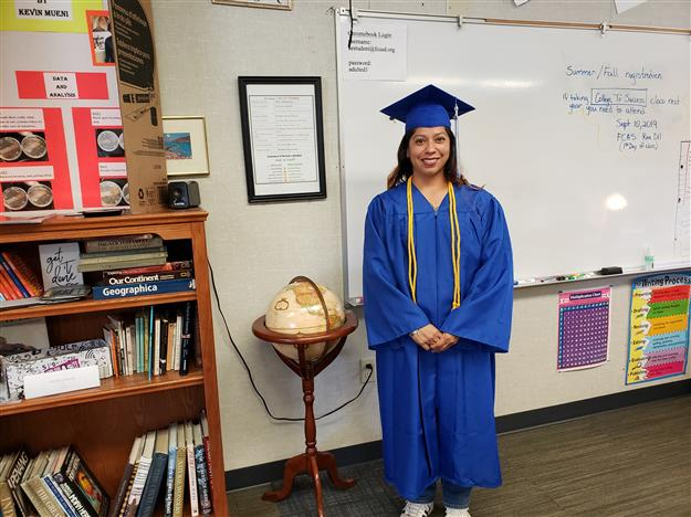 Adult ed student wearing cap and gown