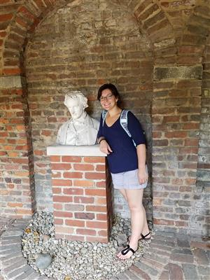 Mrs. Shapley with bust of E.A. Poe